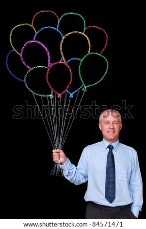 Photo of a mature businessman against a black background holding a bunch of chalk drawn balloons, add your own letters to make a message. - stock photo