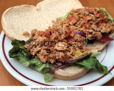 photo of a meal of barbecue sandwiches on a plate
