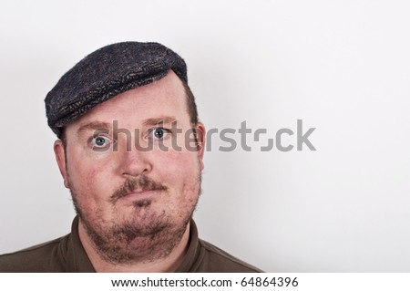 photo of a middle age male portrait on off white backdrop