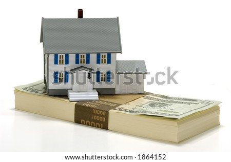 Photo of a Miniature House on Top of Money - Real Estate Concept - stock photo