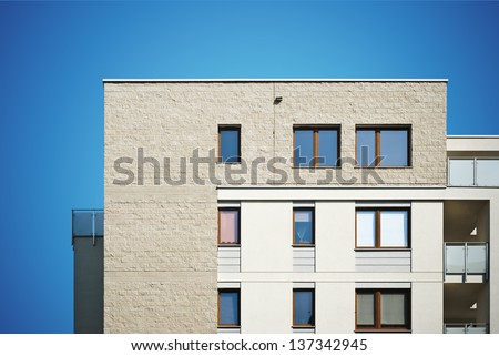 Photo of a new modern residential building with balconies. - stock photo