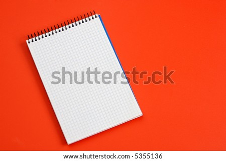 photo of a  notebook over a red background - stock photo