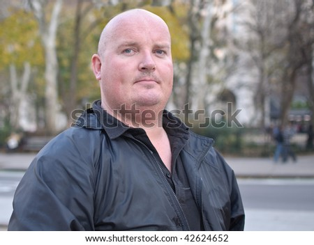 photo of a overweight male in his 30's outside - stock photo