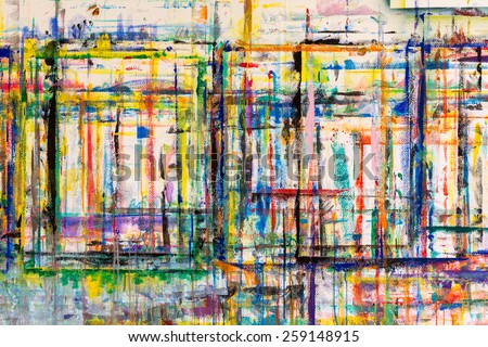Photo of a painters work wall.  Years of paint brush strokes that have gone over the edges of the paper and onto the wall underneath. - stock photo