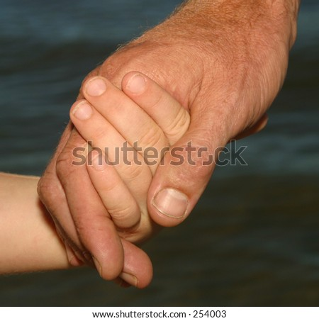 Photo of a parent holding a child hand.