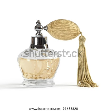 Photo of a perfume spray bottle in the shape of a crown, isolated on white background. - stock photo