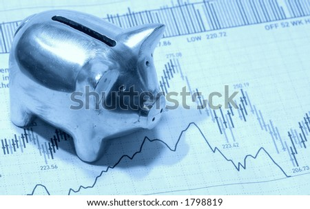 Photo of a Piggy Bank on Top of a Stock Chart in Cyan Tone  - Investment Concept - stock photo