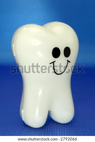 Photo of a Plastic Toy Tooth - Dental Related - stock photo