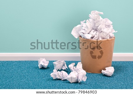 Photo of a recycling waste paper basket on an office floor - stock photo