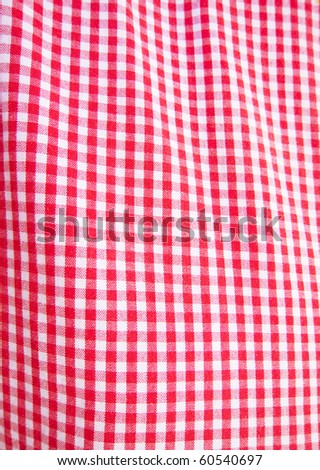 photo of a red and white checkered fabric - stock photo