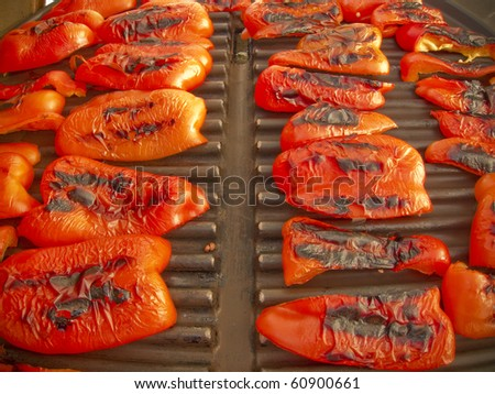 photo of a red roasted sweet peppers on a grill - stock photo