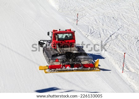Photo of a red snowcat in a ski resort - stock photo