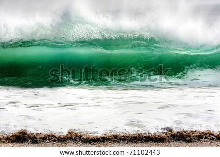 Photo of a rolling wave caught at The Wedge, Newport Beach, California - stock photo