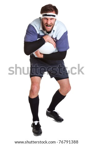 Photo of a rugby player cut out on a white background. - stock photo