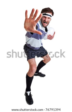 Photo of a rugby player handing off, cut out on a white background. - stock photo