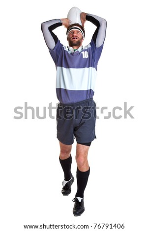 Photo of a rugby player throwing the ball for a line out, cut out on a white background.
