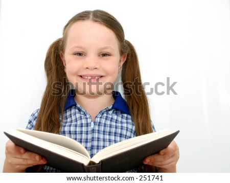 Photo of a school child with a book.