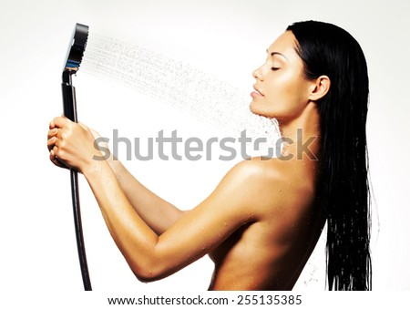 Photo of a sexy beautiful woman in shower washing body under the stream of water - stock photo