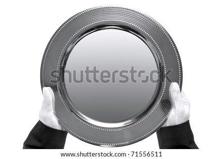 Photo of a silver tray being held by a butler, shot from above and isolated on a white background. - stock photo