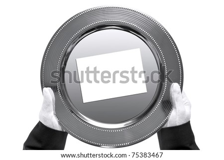 Photo of a silver tray with blank card on being held by a butler, shot from above and isolated on a white background. - stock photo
