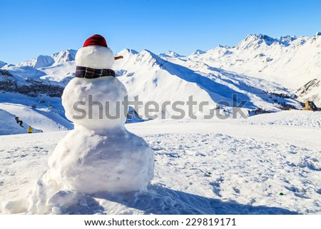 Photo of a snowman in the mountains - stock photo
