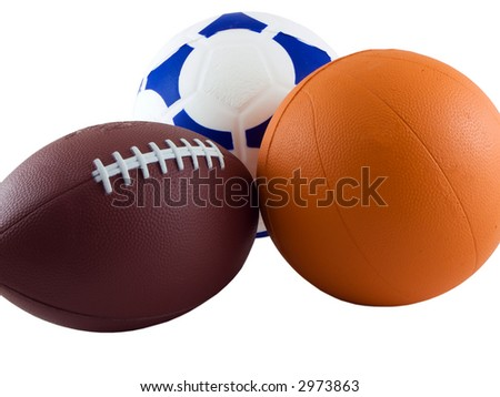 Photo of a soccer ball, football, and basketball isolated on white