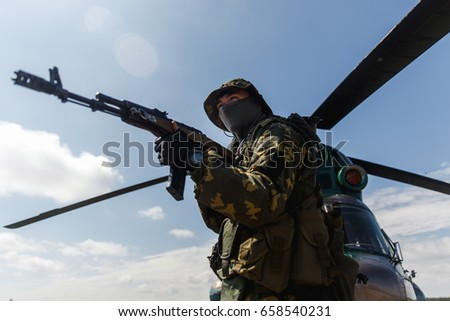 Photo of a soldier with an automatic rifle
