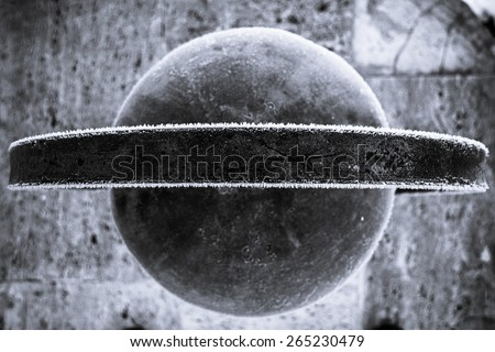 Photo of a street lamp taken from an interesting angle, looks like Saturn. Shallow depth of field. - stock photo