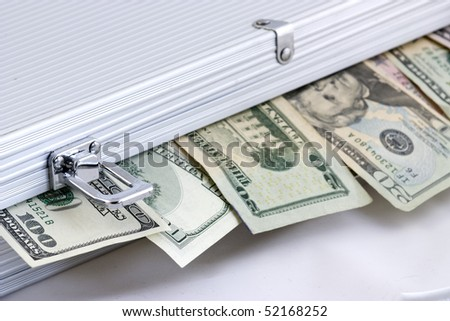 photo of a suitcase full of money