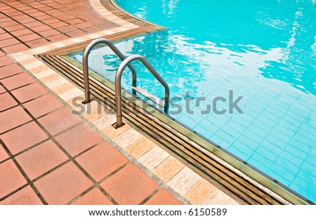 Photo of a swimming pool surrounded by brick floor. - stock photo