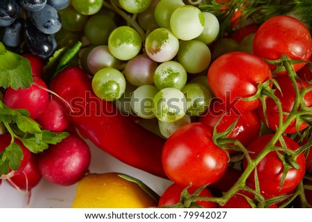 Photo of a table top full of fresh vegetables, fruit, and other healthy foods - stock photo
