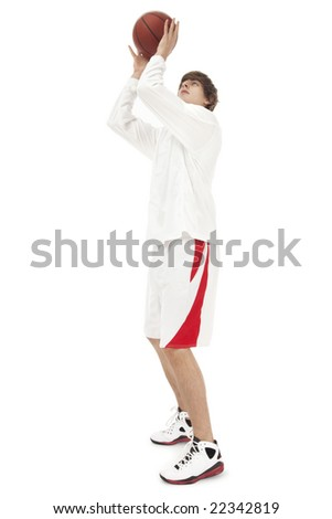 Photo of a teenage basketball player, catching the ball (slight motion blur) - stock photo