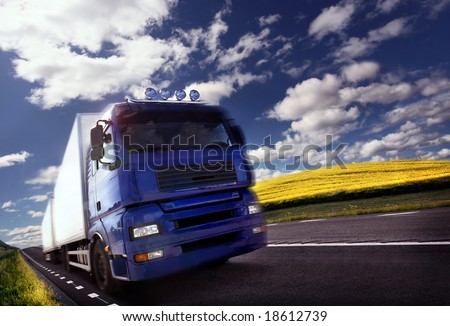 Photo of a truck driving at day/motion blur - stock photo