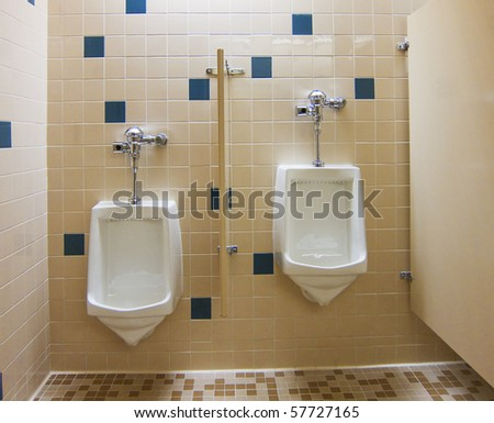 photo of a urinals in a public restroom - stock photo