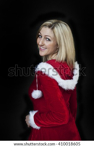 Photo of a very attractive blonde in a Santa Claus dress. - stock photo
