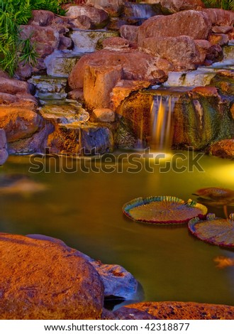 photo of a water stream flowing thru the rocks - stock photo