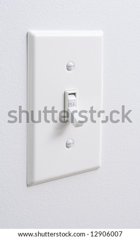 Photo of a white light switch - stock photo