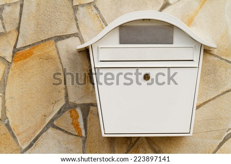 Photo of a white mailbox on the wall - stock photo