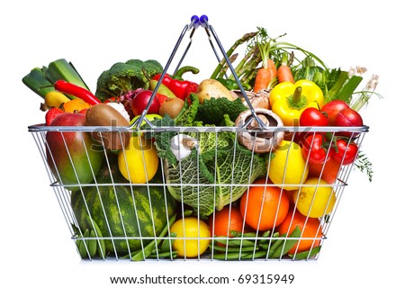 Photo of a wire shopping basket full of fresh fruit and vegetables, isolated on a white background. - stock photo