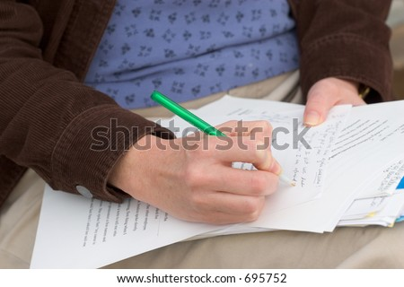 Photo of a woman grading papers - stock photo