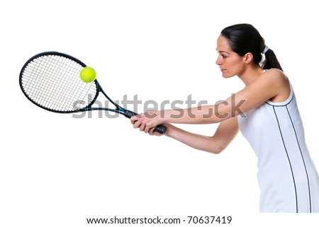 Photo of a woman playing a tennis forehand shot, isolated on white. - stock photo