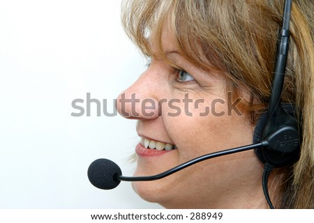 Photo of a woman with a headset on.