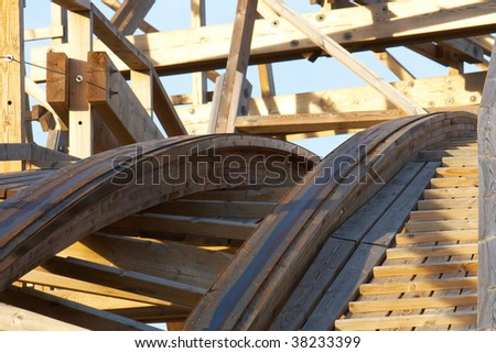 Photo of a wooden roller coaster - stock photo