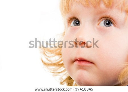 Photo of adorable child with grey eyes looking aside - stock photo