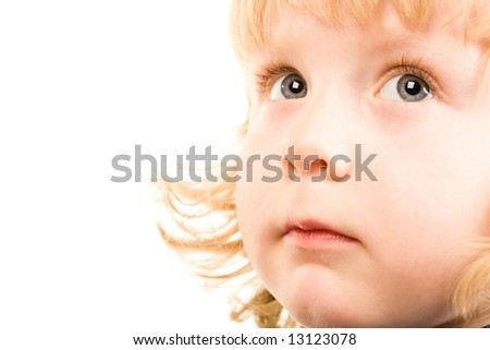Photo of adorable child with grey eyes looking up - stock photo
