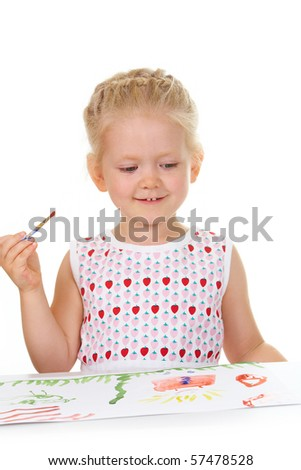 Photo of adorable girl painting with aquarelle and looking at her picture - stock photo