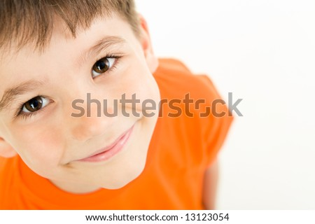 Photo of adorable young boy looking at camera - stock photo