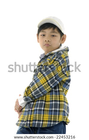 Photo of adorable young boy looking at camera