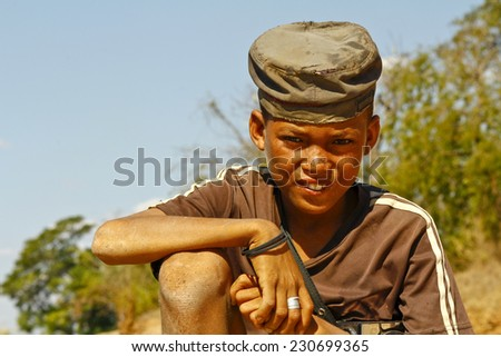 Photo of adorable young happy boy - african poor child - stock photo