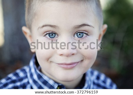 Photo of adorable young happy boy looking at camera - stock photo